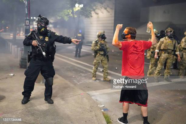 Federal officer tells fellow officers to arrest a protester in front of the Mark O. Hatfield U.S. Courthouse on July 21, 2020 in Portland, Oregon....