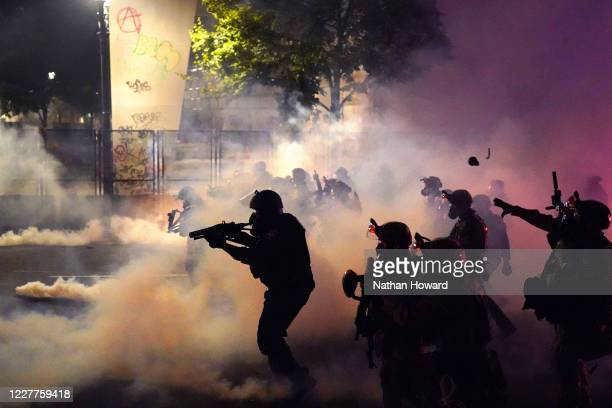 Federal officers deploy tear gas and lesslethal munitions while dispersing a crowd of about a thousand protesters in front of the Mark O Hatfield US...