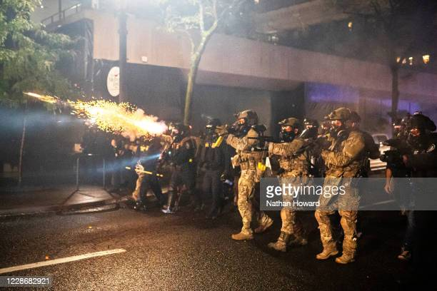 Federal officers disperse a crowd on September 23 2020 in Portland United States Violent protests erupted across the nation Wednesday following the...