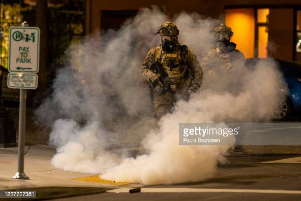 Federal officers operate amid tear gas while clearing the street in front of the Mark O Hatfield US Courthouse on July 21 2020 in Portland Oregon The...