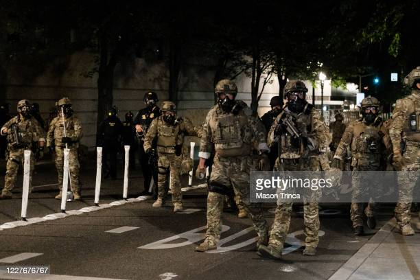 Federal officers prepare to disperse the crowd of protestors outside the Multnomah County Justice Center on July 17 2020 in Portland Oregon Federal...
