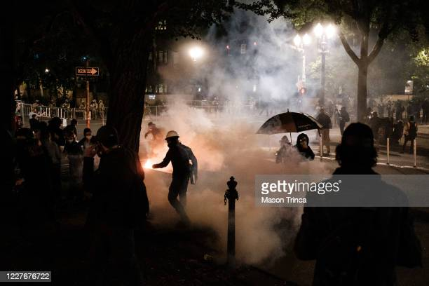 Federal officers use tear gas and other crowd dispersal munitions on protesters outside the Multnomah County Justice Center on July 17 2020 in...