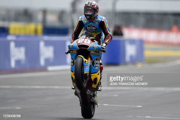 Federal Oil Gresini Kalex Moto 2's German rider Sam Lowes lifts the front wheel as he crosses the finish line to win the French Moto2 race in Le...