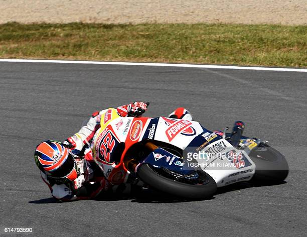 Federal Oil Gresini Moto2's British rider Sam Lowes falls at the hair pin turn during Moto2class third free practice session at the Japanese Grand...