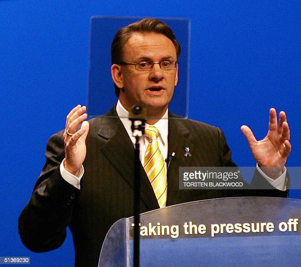 Federal opposition leader Mark Latham speaks through the cue screen to the party faithful at the Labor Party campaign launch in Brisbane 29 September...