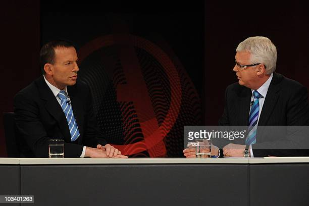 Federal opposition leader Tony Abbott with presenter Tony Jones during the ABC's Q & A television program at the Casula Powerhouse on August 16, 2010...