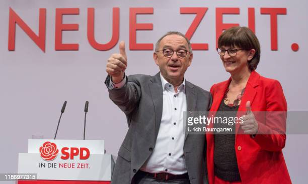 Federal party convention of the SPD in Berlin Norbert Walter Borjans and Saskia Esken after the election to SPD party chairmanship slogan New Time