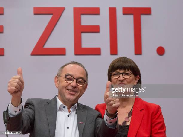 Federal party convention of the SPD in Berlin Norbert Walter Borjans and Saskia Esken after the election to SPD party chairmanship slogan Time