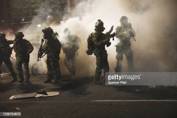 Federal Police clash with protesters in front of the Mark O. Hatfield federal courthouse in downtown Portland as the city experiences another night...