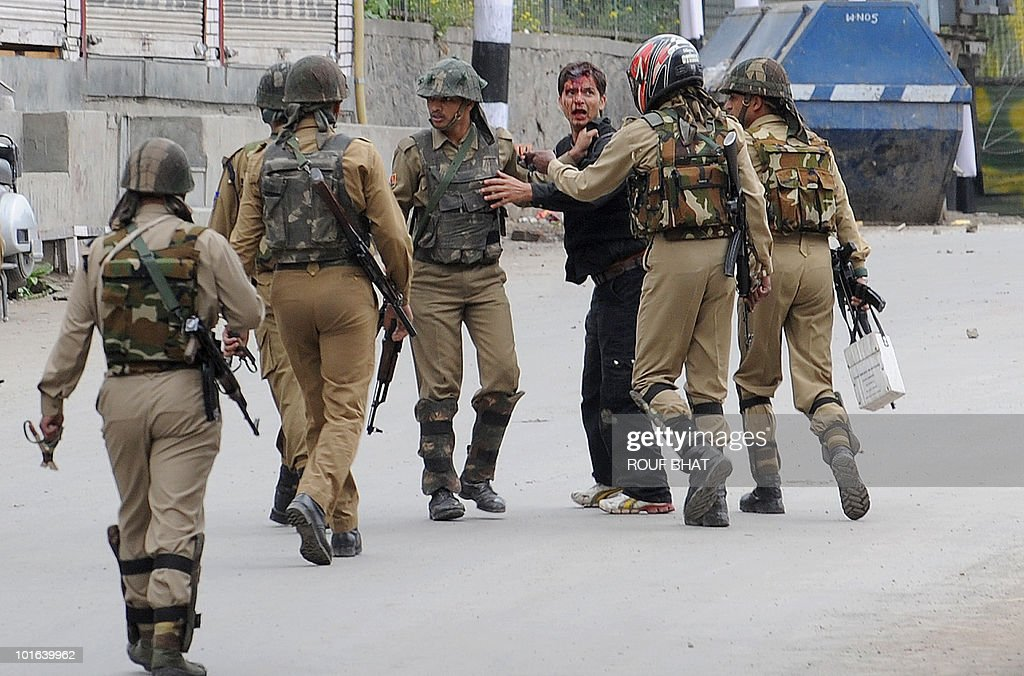 Federal police detain an injured Kashmiri protestor in Srinagar on June 5, 2010. Police fired rubber bullets and teargas to quell hundreds of rock-throwing protesters who were angered as rumours spread of underwear being printed with a picture of the Al-Aqsa mosque, one of Islam's holiest shrines. AFP PHOTO/Rouf BHAT