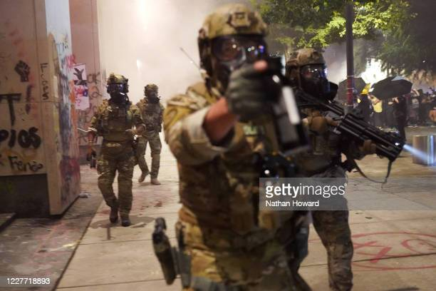 Federal police disperse a crowd of about a thousand protesters at the Mark O Hatfield US Courthouse on July 20 2020 in Portland Oregon The federal...