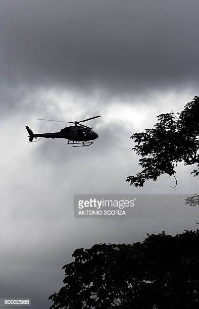 A Federal Police helicopter overflies the Amazon rain forest searching for a clandestine sawmill in the outskirts of Tailandia Para northen Brazil on...