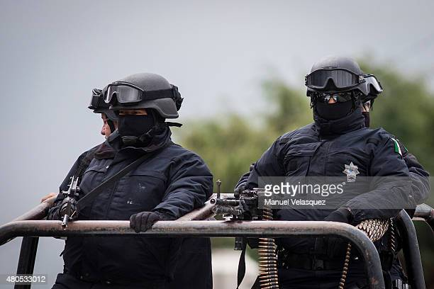 """Federal Police men patrol near of the Maximum Security Prison of """"El Altiplano"""" during an operation on the surroundings of Mexican Maximum Security..."""