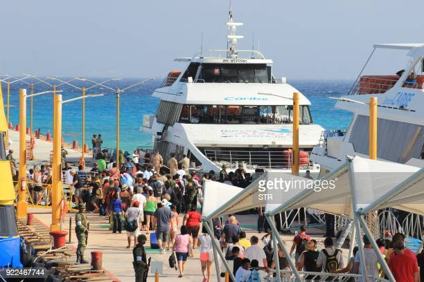 Federal police officers and army soldiers arrive at the dock where an explosion occurred on a ferry in Playa del Carmen Quintana Roo state Mexico on...