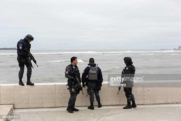 Federal police officers stand guard in Veracruz Mexico on Sunday Jan 8 2017 Mexico's National Association Of Retail And Department Stores says that...