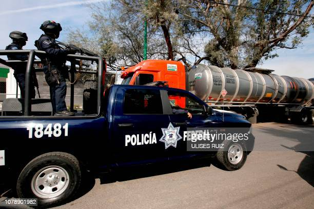 Federal police patrol outside a Pemex storage and distribution center in El Salto Jalisco state as part of measures taken due to the shortage of fuel...