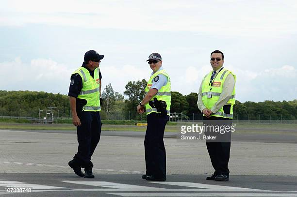 Federal Police prepare for Oprah's arrival at the Cairns airport on December 8 2010 in Cairns Australia Oprah Winfrey is in Australia with 302...