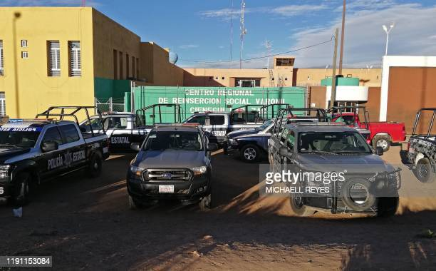 Federal Police vehicles remain outside the Regional Center for Social Reinsertion after a riot in Zacatecas Mexico on December 31 2019 A prison riot...