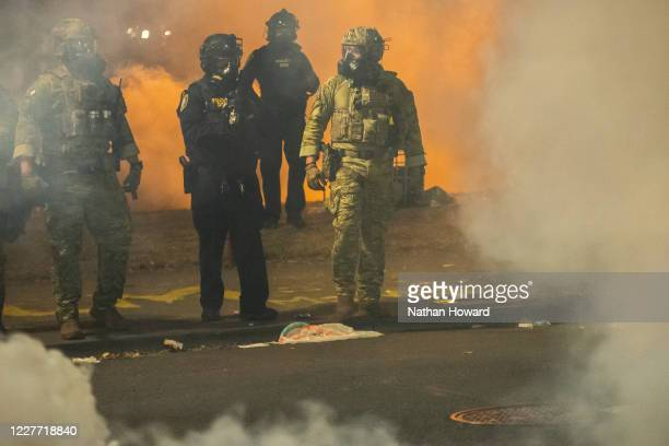 Federal police walk through tear gas while dispersing a crowd of about a thousand protesters at the Mark O Hatfield US Courthouse on July 21 2020 in...