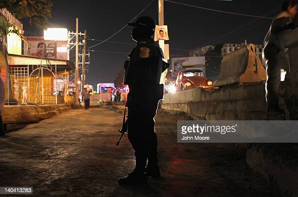 Federal policeman stands guard at the scene of a suspected drug-related execution on March 1, 2012 in Acapulco, Mexico. Drug violence surged in the...