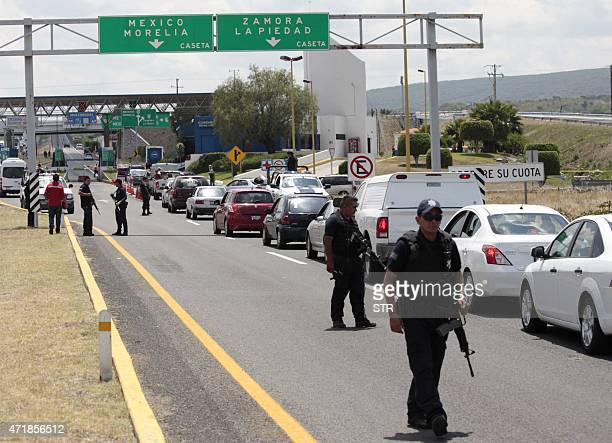 Federal policemen secure the highway bewteen Guadalajara in Jalisco state and Leon city in Guanajuato State Mexico on May 01 2015 More than a dozen...