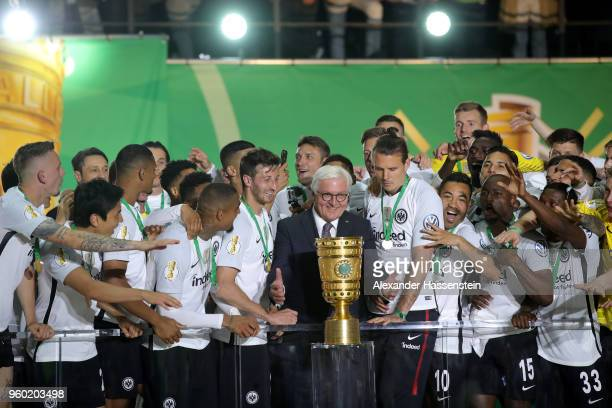Federal President FrankWalter Steinmeier hands over the trophy to team Captain David Abraham of Eintracht Frankfurt after winning the DFB Cup final...