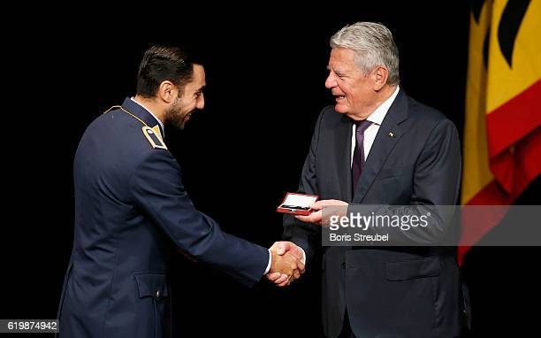 Federal President Joachim Gauck awards boxer Artem Harutyunyan the Silbernes Lorbeerblatt during the Silbernes Lorbeerblatt Award Ceremony at...