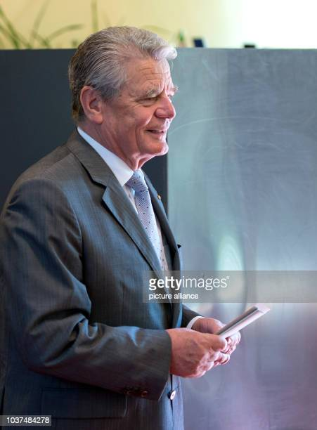 Federal president Joachim Gauck is pictured during he hands in his ballot paper for the European election 2014 and for the referendum about the...