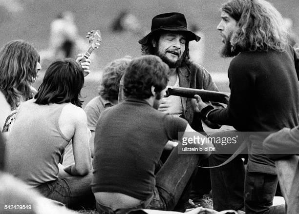 Federal Republic of Germany Bavaria Munich beatniks playing the guitar in the park 'Englischer Garten' Photographer Gert Kreutschmann 1973Vintage...