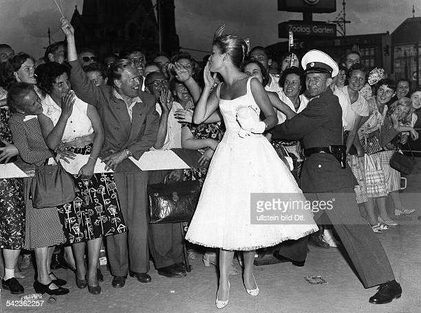 Federal Republic of Germany Berlin Cheering fans greet actress Susanne Cramer in front of the Zoo Palast Cinema during the Berlin Film Festival 1957...