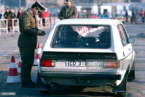 Federal Republic of Germany Berlin The fall of the wall Border crossing at Potsdamer Platz GDR border soldier checking a GDR inhabitant