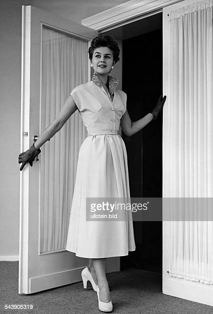 Federal Republic of Germany Vienna Vienna Model wearing a sleeveless dress with a little short-sleeved jacket. - Photographer: Karl Ludwig Haenchen-...