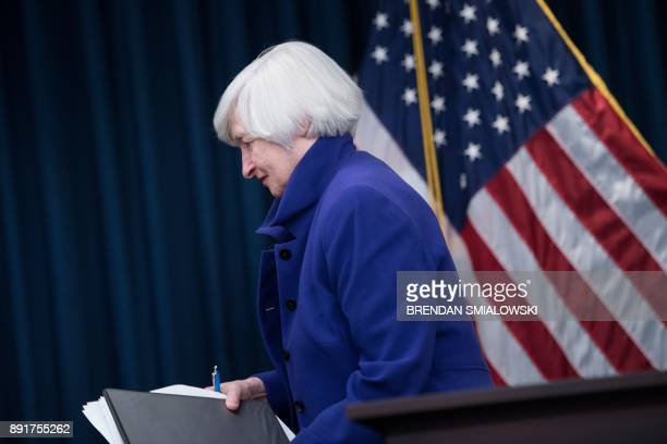 Federal Reserve Board Chair Janet Yellen leaves after speaking during a briefing at the US Federal Reserve December 13 2017 in Washington DC The US...