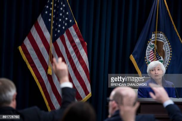 Federal Reserve Board Chair Janet Yellen listens during a briefing at the US Federal Reserve December 13 2017 in Washington DC The US central bank on...