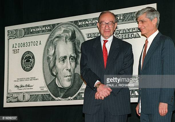 Federal Reserve Board Chairman Alan Greenspan and US Treasury Secretary Robert Rubin stand in front of a poster of the likeness of the new 20 USD...