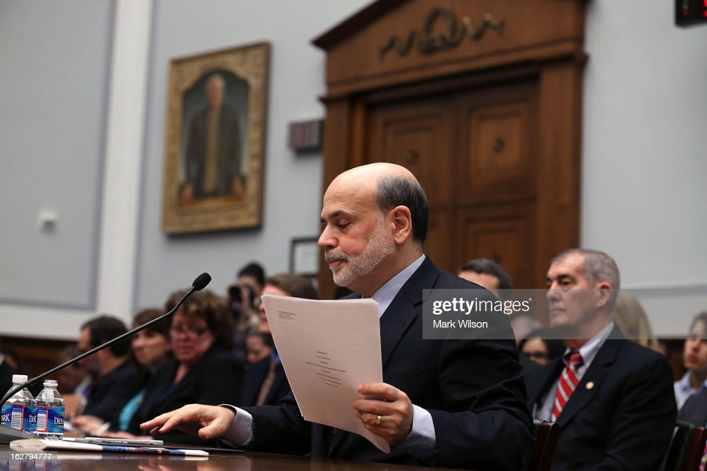 Federal Reserve Board Chairman Ben Bernanke holds his papers while testifing before a House Financial Services Committee, on Capitol Hill, February 27, 2013 in Washington, DC. The committee is hearing testimony from Chairman Bernanke on the state if the U.S. economy and monetary policy.