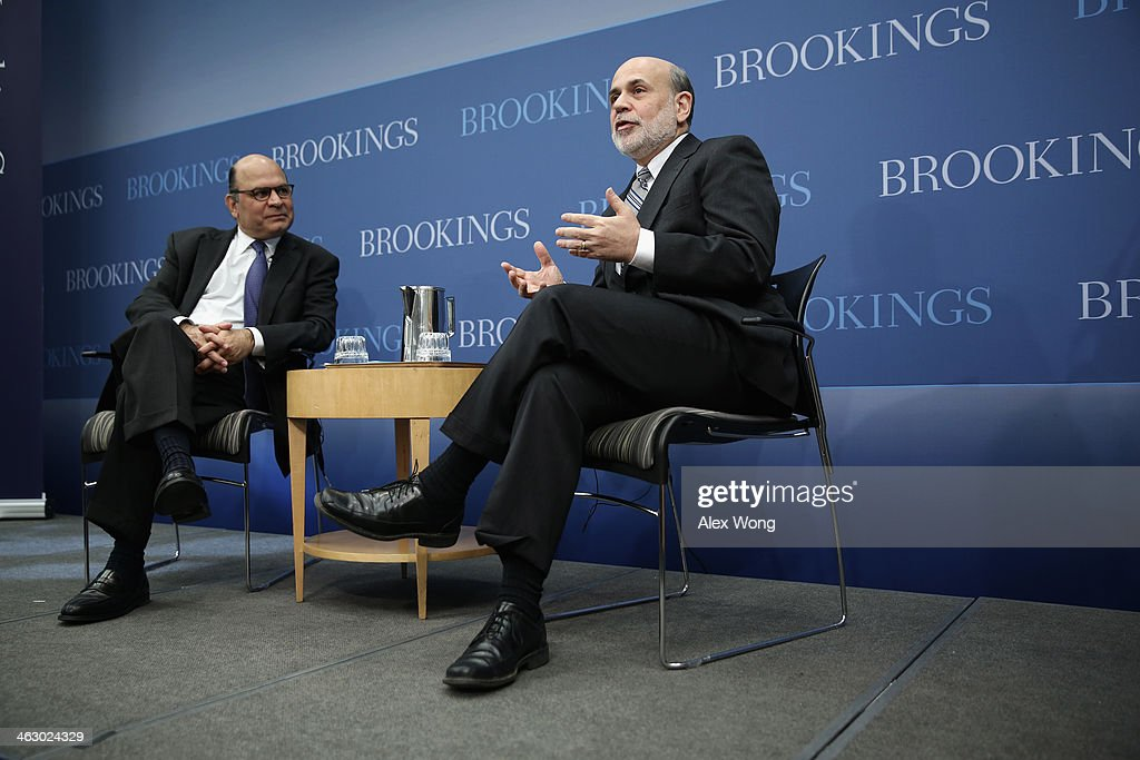 Federal Reserve Board Chairman Ben Bernanke (R) speaks as author and a member of the Board of Trustees of the Brookings Institution Liaquat Ahamed (L) listens during a session at the Brookings Institution January 16, 2014 in Washington, DC. Bernanke spoke on 'Central Banking after the Great Recession: Lessons Learned and Challenges Ahead.'