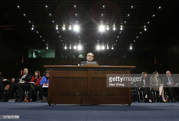 Federal Reserve Board Chairman Ben Bernanke testifies during a hearing before the Senate Budget Committee January 7 2011 on Capitol Hill in...