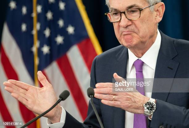 Federal Reserve Board Chairman Jerome Powell arrives to speak at a press conference after the Fed announced interest rates would remain unchanged in...