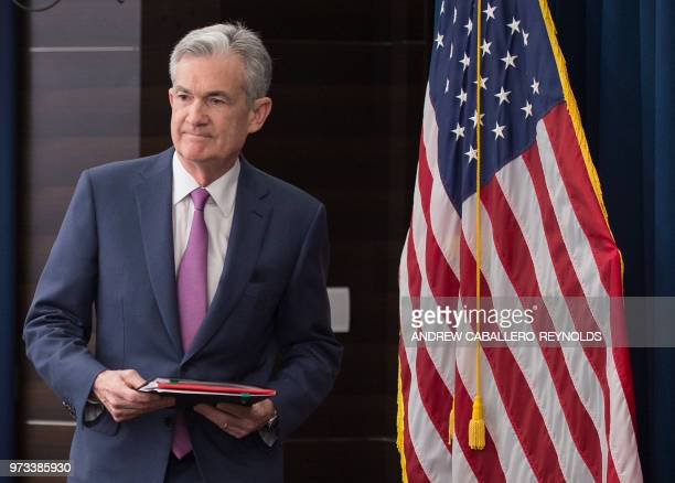 Federal Reserve Board Chairman Jerome Powell arrives to speak at a news conference in Washington DC on June 13 2018 The US Federal Reserve raised the...