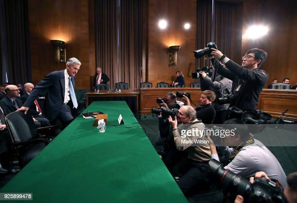 Federal Reserve Board Chairman Jerome Powell arrives to testify during a Senate Banking Housing and Urban Affairs Committee hearing on Capitol Hill...
