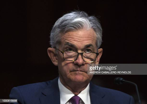 Federal Reserve Board Chairman Jerome Powell looks on during a hearing before the Senate Banking Housing and Urban Affairs Committee July 17 2018 on...