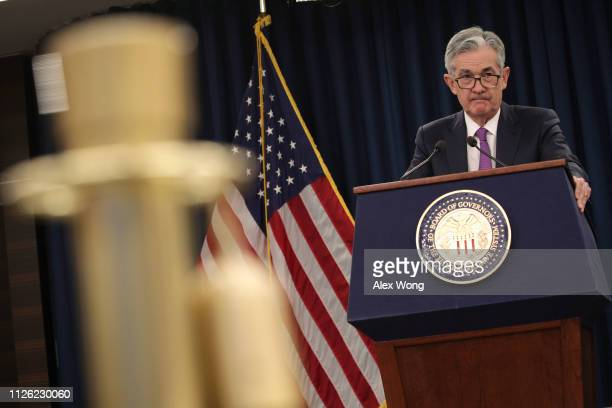 Federal Reserve Board Chairman Jerome Powell pauses during a news conference after a Federal Open Market Committee meeting January 30 2019 in...