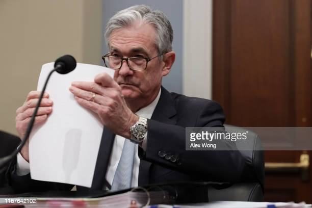 Federal Reserve Board Chairman Jerome Powell prepares his testimony as he waits for the beginning of a hearing before the House Budget Committee...