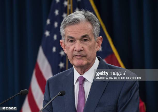 Federal Reserve Board Chairman Jerome Powell speaks during a news conference in Washington DC on June 13 2018 The US Federal Reserve raised the...
