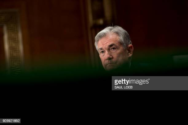 Federal Reserve Board Chairman Jerome Powell testifies during a Senate Banking Housing and Urban Affairs Committee hearing on Capitol Hill in...