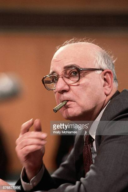 Federal Reserve Board Chairman Paul Volcker puffs on a stogie while testifying before the Senate Banking Committee