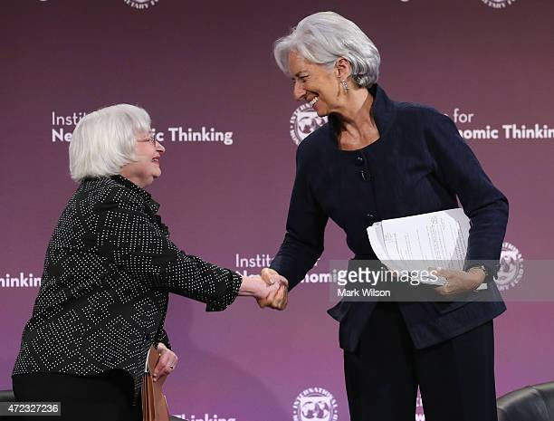 Federal Reserve Board Chairwoman Janet Yellen and International Monetary Fund Managing Director Christine Lagarde shake hands while speaking about...