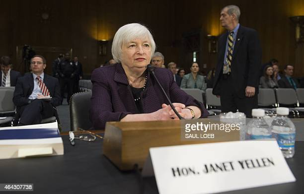 Federal Reserve Board Chairwoman Janet Yellen arrives to testify at the US Senate Banking Housing and Urban Affairs Committee hearing on Capitol Hill...