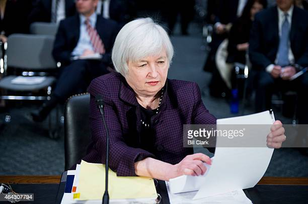 Federal Reserve Board Chairwoman Janet Yellen prepares to testify during the Senate Banking Housing and Urban Affairs Committee hearing on 'The...
